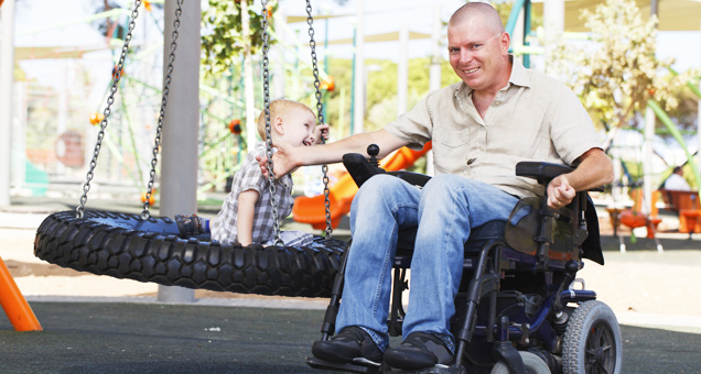 Father enjoying time with his son and using the Aquila SofTech Basic wheelchair cushion.