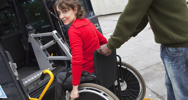 Woman using the Aquila Airpulse PK2 wheelchair cushion system.